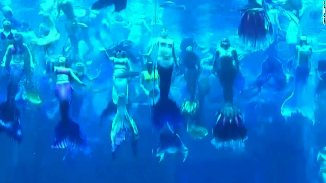 See 100 mermaids in a world record performance
